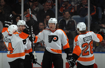 UNIONDALE, NY - MARCH 15: Scott Hartnell #19 of the Philadelphia Flyers celebrates his goal at 7:02 of the second period against the New York Islanders at the Nassau Veterans Memorial Coliseum on March 15, 2012 in Uniondale, New York.  (Photo by Bruce Ben