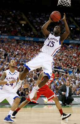 NEW ORLEANS, LA - MARCH 31:  Elijah Johnson #15 of the Kansas Jayhawks goes up for a shot in the lane against the Ohio State Buckeyes during the National Semifinal game of the 2012 NCAA Division I Men's Basketball Championship at the Mercedes-Benz Superdo