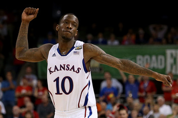 NEW ORLEANS, LA - MARCH 31:  Tyshawn Taylor #10 of the Kansas Jayhawks reacts as the Jayhawks defeat the Ohio State Buckeyes 64-62 during the National Semifinal game of the 2012 NCAA Division I Men's Basketball Championship at the Mercedes-Benz Superdome