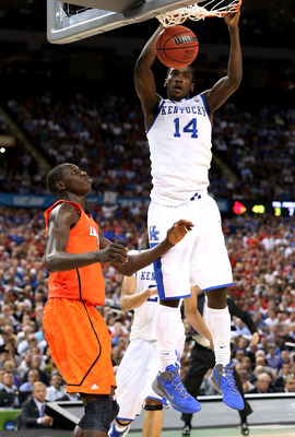 NEW ORLEANS, LA - MARCH 31:  Michael Kidd-Gilchrist #14 of the Kentucky Wildcats dunks the ball next to Gorgui Dieng #10 of the Louisville Cardinals in the second half during the National Semifinal game of the 2012 NCAA Division I Men's Basketball Champio