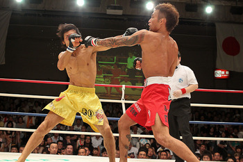 Yuki Shojo (yellow trunks) was the first man to submit Yasuhiro Urushitani, yet he continues to fly under the radar in the flyweight division. (Sherdog)