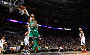 Josh Smith rejects Rajon Rondo at the rim.