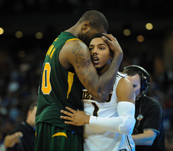 O'Quinn consoling Pressey after the biggest upset in over a decade.