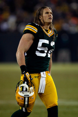 GREEN BAY, WI - JANUARY 15:   Clay Matthews #52 of the Green Bay Packers walks on the field against the New York Giants during their NFC Divisional playoff game at Lambeau Field on January 15, 2012 in Green Bay, Wisconsin.  (Photo by Scott Boehm/Getty Ima