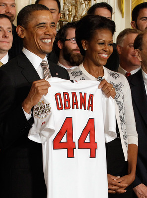Barack Obama celebrates the Cardinals' World Series title with St Louis.