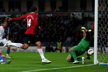 BLACKBURN, ENGLAND - APRIL 02:  Paul Robinson of Blackburn Rovers clears the shot of Javier Hernandez of Manchester United off the line during the Barclays Premier League match between Blackburn Rovers and Manchester United at Ewood Park on April 2, 2012
