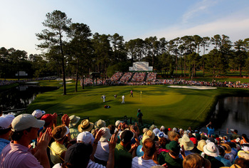 A view from one of two large grandstands on either side of the 15th green