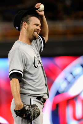 MINNEAPOLIS, MN - SEPTEMBER 7: John Danks #50 of the Chicago White Sox reacts to giving up a two RBI single to Danny Valencia #19 of the Minnesota Twins in the third inning on September 7, 2011 at Target Field in Minneapolis, Minnesota. (Photo by Hannah F