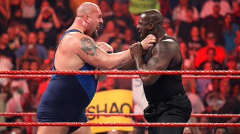 Big Show and Shaq choke each other out.
