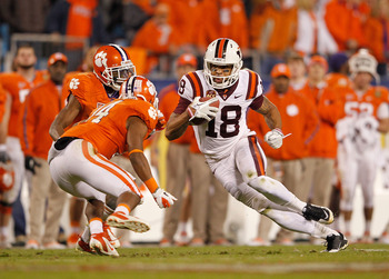 The Hokies' Jarrett Boykin (18) makes an upfield move after catching a pass against Clemson.