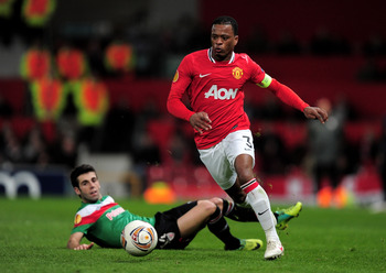 MANCHESTER, ENGLAND - MARCH 08:  Patrice Evra of Manchester United goes past Markel Susaeta of Athletic Bilbao during the UEFA Europa League Round of 16 first leg match between Manchester United and Athletic Bilbao at Old Trafford on March 8, 2012 in Manc