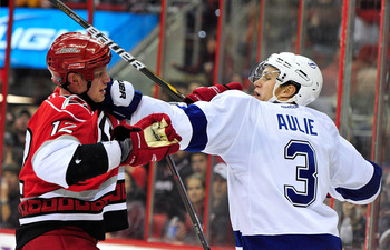 Eric Staal (left) jousts with former Maple Leaf, and current Tampa Bay Lightning defender Keith Aulie