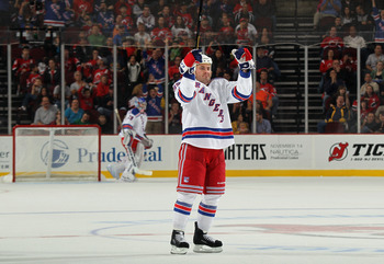 NEWARK, NJ - SEPTEMBER 23: Brendan Bell #39 of the New York Rangers scores the game winning goal at 16:56 of the third period against the New Jersey Devils at the Prudential Center on September 23, 2011 in Newark, New Jersey. The Rangers defeated the Devi