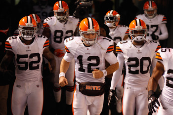 PITTSBURGH, PA - DECEMBER 08:  (L-R) D'Qwell Jackson #52, Colt McCoy #12 and Mike Adams #20 of the Cleveland Browns take the field against the Pittsburgh Steelers at Heinz Field on December 8, 2011 in Pittsburgh, Pennsylvania.  (Photo by Jared Wickerham/G