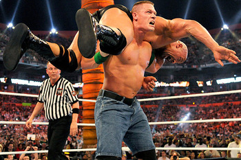 John Cena delivers an Attitude Adjustment to The Rock. (Courtesy of WWE.com)