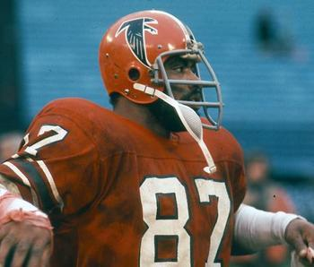 Claude Humphries wearing red jersey with red helmet look. Photo courtesy of http://www.profootballhof.com/photos/611/2008/8/27/