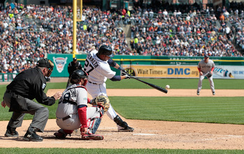 DETROIT, MI - APRIL 05: Jhonny Peralta #27 of the Detroit Tigers singles to left field in the ninth inning during the opening day game against the Boston Red Sox at Comerica Park on April 5, 2012 in Detroit, Michigan. The Tigers defeated the Red Sox 3-2.