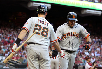 "Buster Posey drops the newly developed ""2 percent"" handshake on Melky Cabrera."