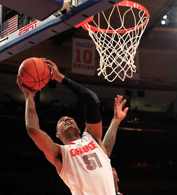 NEW YORK, NY - MARCH 09: Fab Melo #51 of the Syracuse Orange drives to the basket against the Cincinnati Bearcats during the semifinals of the Big East men's basketball tournament at Madison Square Garden on March 9, 2012 in New York City.  (Photo by Chri