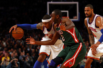 NEW YORK, NY - MARCH 26:  Carmelo Anthony #7 of the New York Knicks drives against Luc Richard Mbah a Moute #12 of the Milwaukee Bucks at Madison Square Garden on March 26, 2012 in New York City. NOTE TO USER: User expressly acknowledges and agrees that,