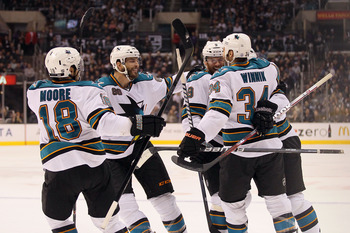 LOS ANGELES, CA - APRIL 05:  (L-R) Dominic Moore #18, Brent Burns #88, Martin Havlat #9, Jason Demers #60 and Daniel Winnik #34 of the San Jose Sharks celebrate Demers' first period goal against the Los Angeles Kings during the NHL game at Staples Center
