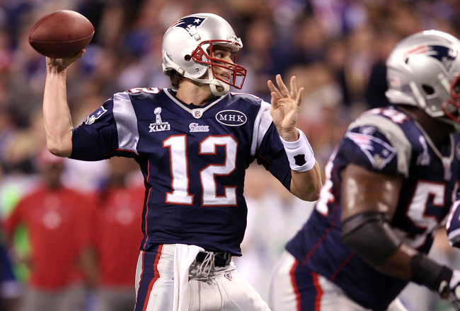 INDIANAPOLIS, IN - FEBRUARY 05:  Quarterback Tom Brady #12 of the New England Patriots looks to throw against the New York Giants during Super Bowl XLVI at Lucas Oil Stadium on February 5, 2012 in Indianapolis, Indiana.  (Photo by Elsa/Getty Images)