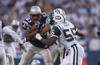 23 Sep 2001: Rod Rutledge #83 of the New England Patriots is stopped by James Farrior #58 and Marvin Jones #55 of the New York Jets during their game at Foxboro Stadium in Foxboro, Massachusetts. The Jets won 10-3. DIGITAL IMAGE. Mandatory Credit: Ezra Sh