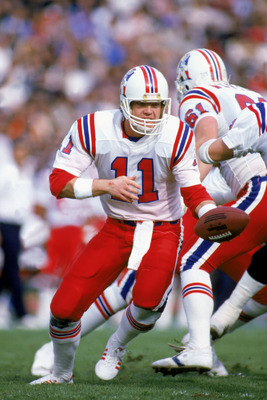 LOS ANGELES - JANUARY 5:  Quarterback Tony Eason #11 of the New England Patriots motions for a hand off during the 1985 AFC Division Playoff against the Los Angeles Raiders at the LA Memorial Coliseum on January 5, 1986 in Los Angeles, California.  The Pa
