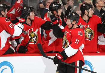 OTTAWA, CANADA - FEBRUARY 25: Daniel Alfredsson #11 of the Ottawa Senators celebrates his first of two goals scored in the third period with teammates during an NHL game against the Boston Bruins at Scotiabank Place on February 25, 2012 in Ottawa, Ontario