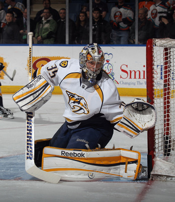 UNIONDALE, NY - JANUARY 16: Pekka Rinne #35 of the Nashville Predators skates in warmups prior to the game against the New York Islanders at the Nassau Veterans Memorial Coliseum on January 16, 2012 in Uniondale, New York. The Predators defeated the Islan