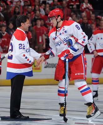 Dino Ciccarelli (left), shakes hands with Alex Ovechkin in 2011.