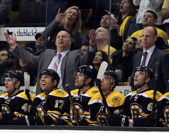 The Bruins' bench watches a replay during a recent home game