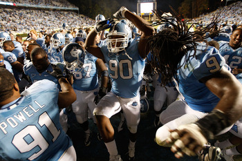 CHAPEL HILL, NC - NOVEMBER 07:  Quinton Coples #90 of the North Carolina Tar Heels celebrates with teammates after a 19-6 victory over the Duke Blue Devils during their game at Kenan Stadium on November 7, 2009 in Chapel Hill, North Carolina.  (Photo by S