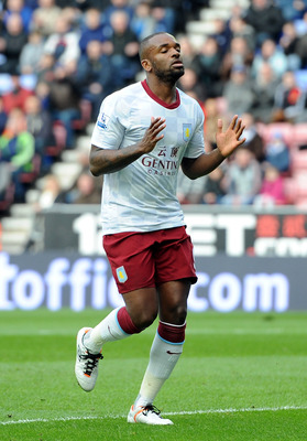 WIGAN, ENGLAND - FEBRUARY 25:  Darren Bent of Aston Villa reacts after missing a good chance during the Barclays Premier League match between Wigan Athletic and Aston Villa at DW Stadium on February 25, 2012 in Wigan, England.  (Photo by Chris Brunskill/G