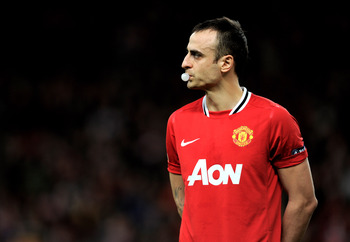 MANCHESTER, ENGLAND - FEBRUARY 23:  Dimitar Berbatov of Manchester United looks on prior to the UEFA Europa League Round of 32 second leg match between Manchester United and AFC Ajax at Old Trafford on February 23, 2012 in Manchester, England.  (Photo by