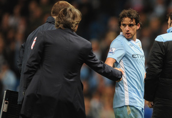 MANCHESTER, ENGLAND - SEPTEMBER 21:  Owen Hargreaves of Manchester City is subbed by manager Roberto Mancini during the Carling Cup Third Round match between Manchester City and Birmingham City at the Etihad Stadium on September 21, 2011 in Manchester, En