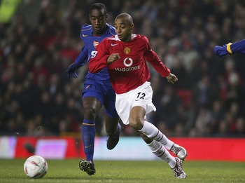 MANCHESTER, ENGLAND - DECEMBER 1:  David Bellion of Manchester United beats Johan Dkorou of Arsenal on his way to scoring the first goal during the Carling Cup match between Manchester United and Arsenal at Old Trafford on December 1 , 2004 in Manchester,
