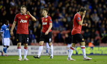 WIGAN, ENGLAND - APRIL 11:  Tom Cleverley, Michael Carrick and Ryan Giggs of Manchester United during the Barclays Premier League match between Wigan Athletic and Manchester United at DW Stadium on April 11, 2012 in Wigan, England.  (Photo by Gareth Cople
