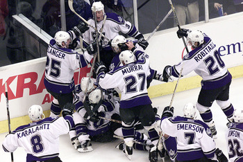 Kings dogpile Adam Deadmarsh after his OT goal eliminated the Wings in 2001.