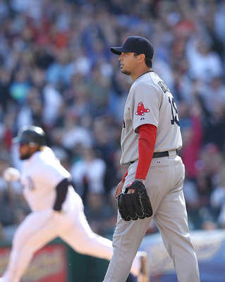 Josh Beckett wonders what went wrong as Prince Fielder circles the bases following a home run.