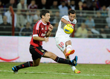 DUBAI, UNITED ARAB EMIRATES - JANUARY 04:  Daniele Bonera (L) of AC Milan and Nene of Paris Saint-Germain FC during the Dubai Challenge Cup match between Paris Saint-Germain FC and AC Milan at Al-Rashid Stadium on January 4, 2012 in Dubai, United Arab Emi