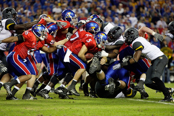 The Kansas offensive line leads the way for Todd Reesing.