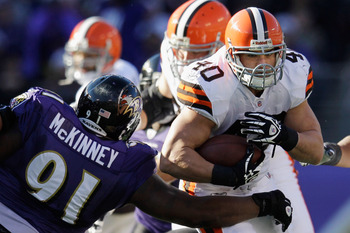 BALTIMORE, MD - DECEMBER 24:  Peyton Hillis #40 of the Cleveland Browns is tackled by Brandon McKinney #91 of the Baltimore Ravens during the first half at M&T Bank Stadium on December 24, 2011 in Baltimore, Maryland.  (Photo by Rob Carr/Getty Images)