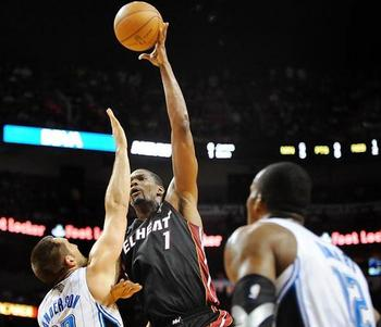 "Chris Bosh will get the ball ""where big men get it."" (Robert Duyos/Sun-Sentinel)"