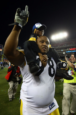TAMPA, FL - FEBRUARY 01:  Casey Hampton #98 of the Pittsburgh Steelers celebrates with his son Casey as he walks off the field after their 27023 win against the Arizona Cardinals during Super Bowl XLIII on February 1, 2009 at Raymond James Stadium in Tamp