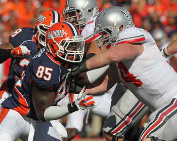 CHAMPAIGN, IL - OCTOBER 15: Whitney Mercilus #85 of the Illinois Fighting Illini rushes against Jack Mewhort #74 of the Ohio State Buckeyes at Memorial Stadium on October 15, 2011 in Champaign, Illinois. Ohio State defeated Illinois 17-7. (Photo by Jonath