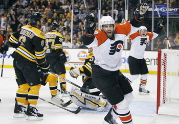 Simon Gagne scores the historic series winner