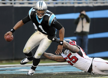 Cam Newton escapes the grasp of Atlanta's John Abraham.