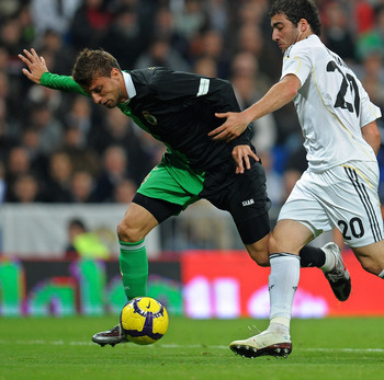 Henrique Fails to deal with Gonzalo Higuain of Real Madrid during a loan spell at Racing Santander