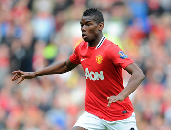 MANCHESTER, ENGLAND - MARCH 11:  Paul Pogba of Manchester United in action during the Barclays Premier League match between Manchester United and West Bromwich Albion at Old Trafford on March 11, 2012 in Manchester, England.  (Photo by Michael Regan/Getty